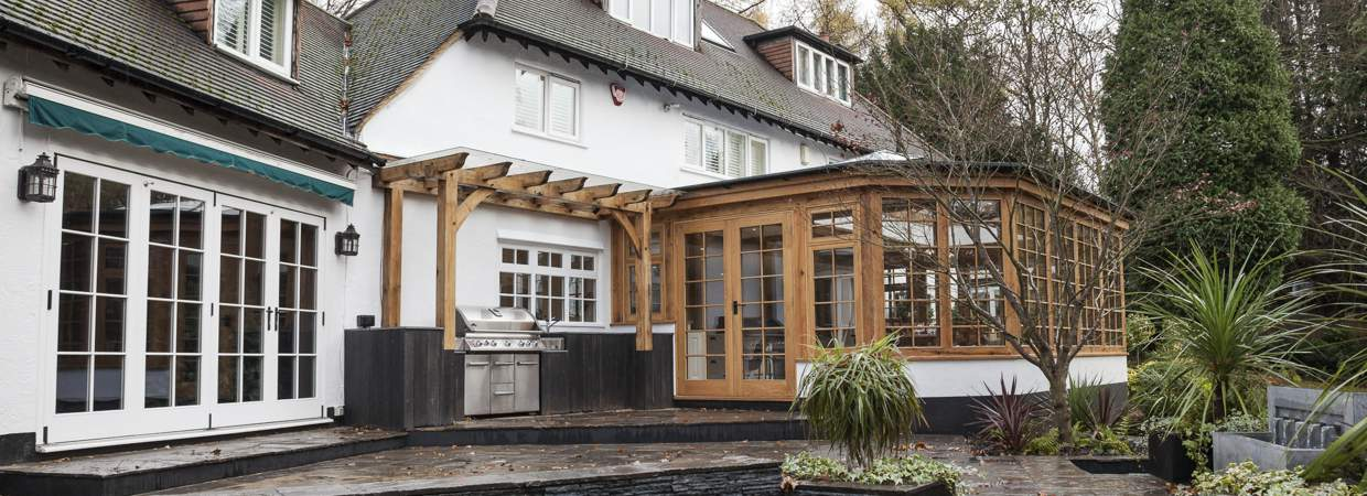 Oak orangery and external kitchen and landscaping, rickmansworth